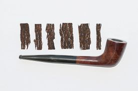 picture of tobacco-pipe  - old wooden smoking pipe and pieces of pressed tobacco close - JPG