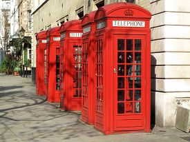 foto of phone-booth  - Traditional red London phone box booths in England - JPG