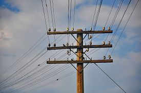 picture of outdated  - An outdated telegraph pole between railroad station which is still functional - JPG
