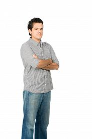pic of disappointed  - Profile of critical judgmental hispanic man in casual clothes with arms crossed looking at camera expressing stoic harsh unhappy disappointed attitude - JPG