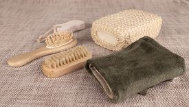 stock photo of pumice-stone  - Small wooden spa set with sponge - JPG