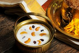 image of pal  - Pudding Pal Payasam Kheer Indian food garnished with cashew and raisin Side View - JPG