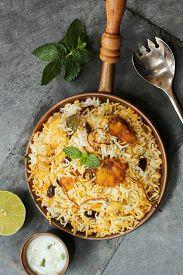 foto of raita  - Fish Biryani with raita made with basmati rice - JPG