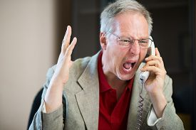 picture of shout  - Angry businessman shouting on the phone - JPG