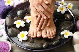 picture of pedicure  - Female feet at spa pedicure procedure - JPG