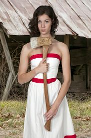 foto of possession  - Beautiful possessed woman in a trance holding an axe - JPG