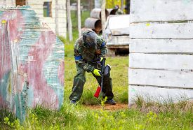 foto of paintball  - Soldier with paintball gun on tactical military training - JPG