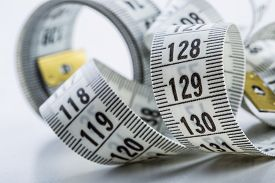 stock photo of measurement  - Curved measuring tape - JPG