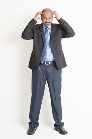image of bald head  - Full body mature Indian business man hands scratching his bald head  - JPG