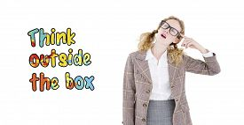image of thinking outside box  - Geeky hipster thinking with finger on temple against think outside the box - JPG