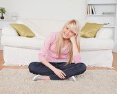 Attractive Blonde Female Posing While Sitting On The Floor