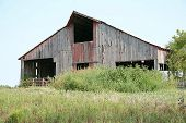 stock photo of wanton  - Here is a very sad looking barn that has been abandoned - JPG