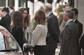 LONDON, ENGLAND - APRIL 28: Kate Middleton (far left, smiling) arrives at the Goring Hotel on the ev
