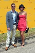 NEW YORK - JUNE 26: Singer Rob Thomas and his wife, Marisol, attend the Veuve Clicquot Polo Classic