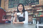 Small Business: Happy Owner Of A Cafe. Young Startup Owner Small Cafe Shop. poster