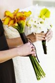 hands holding boquets of beautiful flowers