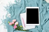 Flat Lay Tablet, Phone, Cup Of Coffee And Flowers On White Blanket With Turquoise Plaid poster