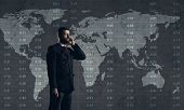 Businessman with smartphone standing over diagram. World map background. Business, globalization, ca poster