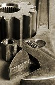wrench, gear-wheel and nut in black and brown- Duplex-effect poster