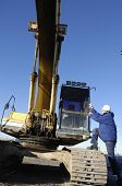 picture of jcb  - driver boarding large bulldozer - JPG