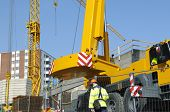 image of construction crane  - mobile cranes inside construction site - JPG