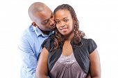 Black young couple isolated over a white background.