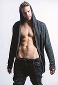 Time Change Clothes. Man Handsome Sexy Undressing. Hipster Sexy Muscular Torso Take Off Clothes. Sed poster