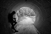 Mystery Hoody Man Holding Dslr Camera Leaning In The Tunnel. Travel Photography Concept poster