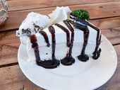 Crape Cake With Chocolate Sauce And Icecream On Plate poster
