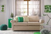 Comfortable Couch Near Window In Modern Living Room Interior poster