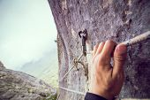 Worn Out And Damaged Rapid Carbine With Rope For Rappeling In The Rock  In Mountains. Hand Holds The poster