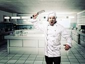 portrait of angry chef in modern kitchen