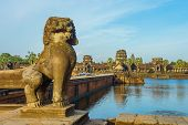 Ancient Temple Angkor Wat From Across The Lake. The Largest Religious Monument In The World. Siem Re poster