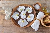 Spa Wellness Relax concept. Spa background with spa accessories on wooden background.  poster