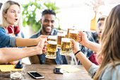 Happy Multiracial Friends Drinking And Toasting Beer At Brewery Bar - Friendship Concept With Young  poster