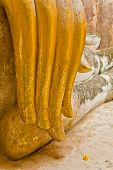 image of chums  - The hand of Phra Atchana the big image of Buddha and a little flower on the floor in Sri Chum temple the Sukhothai Historic Park Thailand - JPG