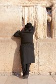 An Religious Ultra-orthodox Jew Prays At The Wailing Wall