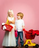Girl And Boy Children Shopping. Couple Kids Hold Plastic Shopping Basket Toy. Kids Store. Mall Shopp poster