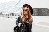 Gorgeous Red-haired Hipster Young Woman In Dark Sunglasses In An Elegant Hat In A Stylish Black Leat poster
