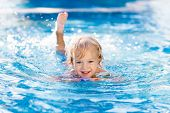 Child Learning To Swim. Kids In Swimming Pool. poster