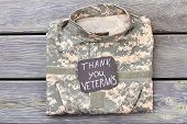 Veterans Camo Jacket, Top View. Thank You Veterans, Wooden Background. poster