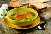 foto of giblets  - Soup of chicken giblets and red lentils in a green bowl - JPG