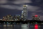 stock photo of prudential center  - Boston skyline on a cloudy night - JPG