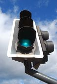 foto of traffic light  - Worm view of UK traffic sign set on green - JPG