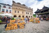 KAZIMIERZ DOLNY, POLAND - JUL 14: Unidentified people walking on the old town of Kazimierz Dolny at Vistula river on 14 of July 2013. This town is an art center of Poland with many paint galleries.