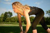 Female Model Exercises In The Park