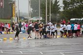 Runners Participate In Huge Water Balloon Fight After Running Race