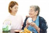 stock photo of politeness  - Friendly nurse cares for an elderly woman - JPG