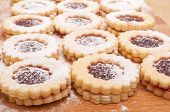 image of linzer  - Closeup of Traditional Linzer Cookies on Wooden Board - JPG