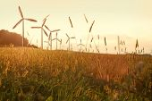 stock photo of wind wheel  - wind generator turbines on sunset - JPG